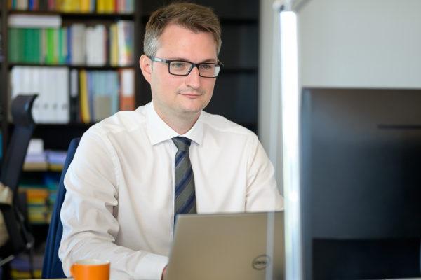 adrian-huber-working-laptop